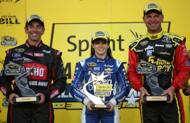 CHARLOTTE, NC - MAY 15:  First Round winner Greg Biffle, driver of the #16 Ortho Ford, Sprint Fan Vote winner Danica Patrick, driver of the #10 Mobil 1/Aspen Dental Chevrolet, and Second Round winner Clint Bowyer, driver of the #15 Cherry 5-Hour Energy/Special Operations Warrior Foundation Toyota, pose in Victory lane after the NASCAR Sprint Cup Series Sprint Showdown at Charlotte Motor Speedway on May 15, 2015 in Charlotte, North Carolina.  (Photo by Nick Laham/NASCAR via Getty Images)