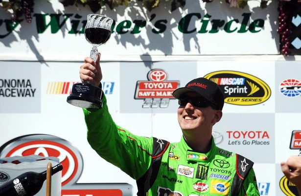 SONOMA, CA - JUNE 28:  Kyle Busch, driver of the #18 M&M's Crispy Toyota, celebrates after winning the NASCAR Sprint Cup Series Toyota/Save Mart 350 at Sonoma Raceway on June 28, 2015 in Sonoma, California.  (Photo by Rainier Ehrhardt/NASCAR via Getty Images)