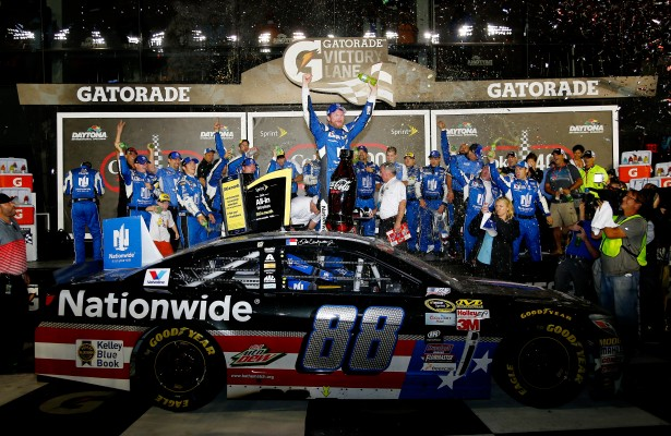 DAYTONA BEACH, FL - JULY 06:  Dale Earnhardt Jr., driver of the #88 Nationwide Stars and Stripes Chevrolet, celebrates in Victory Lane after winning the NASCAR Sprint Cup Series Coke Zero 400 Powered by Coca-Cola at Daytona International Speedway on July 6, 2015 in Daytona Beach, Florida.  (Photo by Jerry Markland/Getty Images)