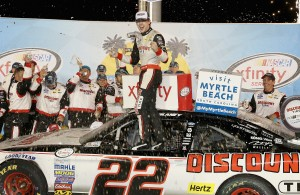 SPARTA, KY - SEPTEMBER 26:  Ryan Blaney, the driver of the #22 Discount Tire Ford celebrates in Victory Lane after winning the the NASCAR Xfinity Series VisitMyrtleBeach.com 300  at Kentucky Speedway on September 26, 2015 in Sparta, Kentucky.  (Photo by Andy Lyons/Getty Images)