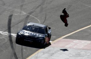 RICHMOND, VA - APRIL 24:  Carl Edwards, driver of the #19 XFINITY Toyota, celebrates with a backflip after winning the NASCAR Sprint Cup Series TOYOTA OWNERS 400 at Richmond International Raceway on April 24, 2016 in Richmond, Virginia.  (Photo by Todd Warshaw/Getty Images)