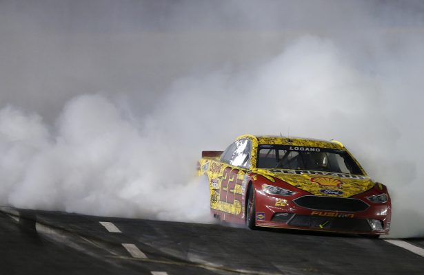 CHARLOTTE, NC - MAY 21:  Joey Logano, driver of the #22 Shell Pennzoil Ford, celebrates with a burnout after winning the NASCAR Sprint Cup Series Sprint All-Star Race at Charlotte Motor Speedway on May 21, 2016 in Charlotte, North Carolina.  (Photo by Brian Lawdermilk/Getty Images)