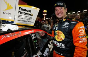 CHARLOTTE, NC - MAY 29:  Martin Truex Jr., driver of the #78 Bass Pro Shops/Tracker Toyota, poses with the winner's decal after winning the NASCAR Sprint Cup Series Coca-Cola 600 at Charlotte Motor Speedway on May 29, 2016 in Charlotte, North Carolina.  (Photo by Todd Warshaw/NASCAR via Getty Images)