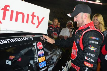 BRISTOL, TN - AUGUST 19: Austin Dillon, driver of the #2 Rheem Chevrolet, places the winner's decal on his car in Victory Lane after winning the NASCAR XFINITY Series Food City 300 at Bristol Motor Speedway on August 19, 2016 in Bristol, Tennessee.  (Photo by Jeff Curry/NASCAR via Getty Images)