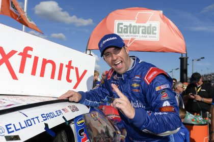 DARLINGTON, SC - SEPTEMBER 03:  Elliott Sadler, driver of the #1 OneMain Chevrolet, applies the winners sticker after winning the NASCAR XFINITY Series VFW Sport Clips Help a Hero 200 at Darlington Raceway on September 3, 2016 in Darlington, South Carolina.  (Photo by Robert Laberge/NASCAR via Getty Images)