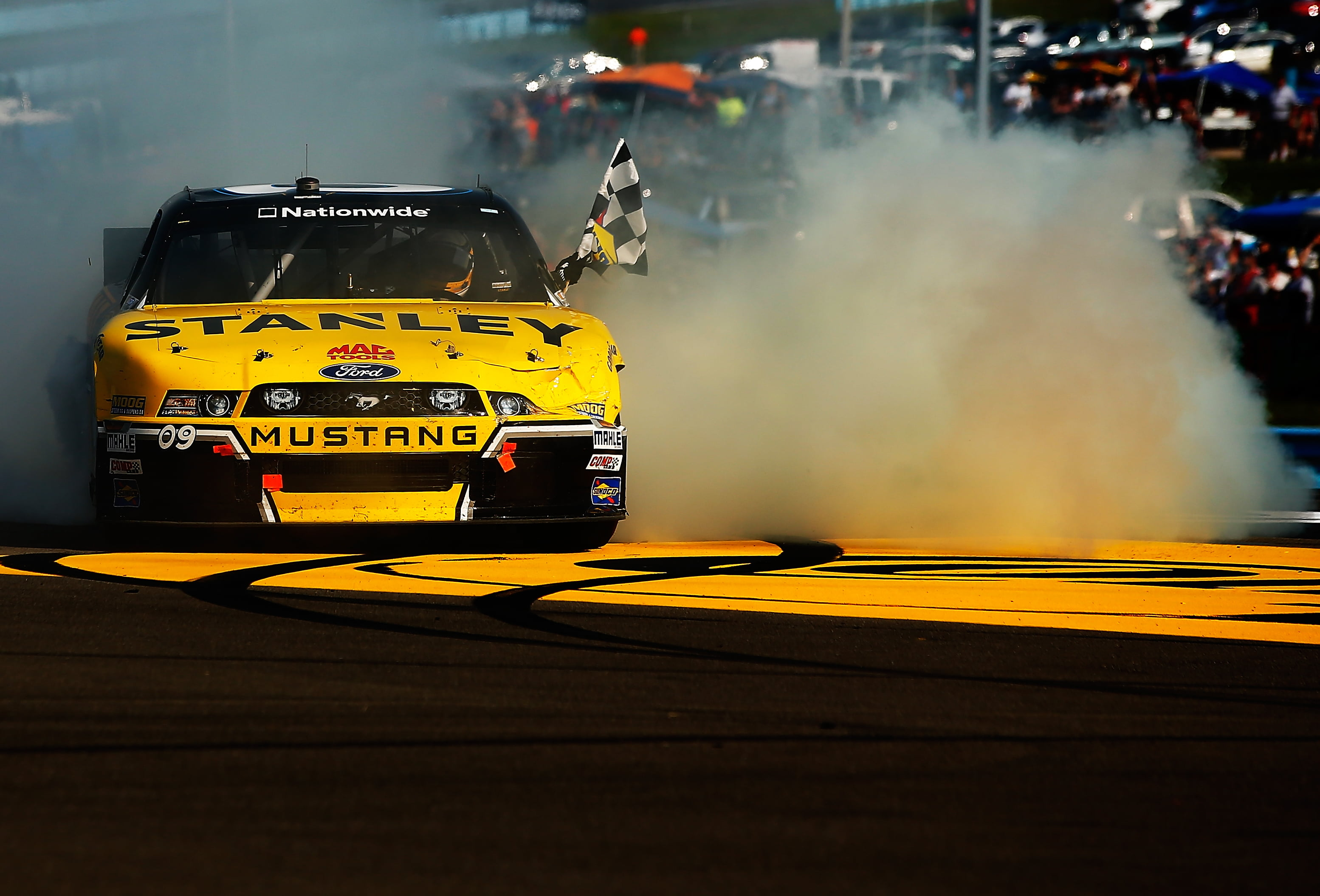 Marcos Ambrose holds on to win Nationwide Race at Watkins Glen