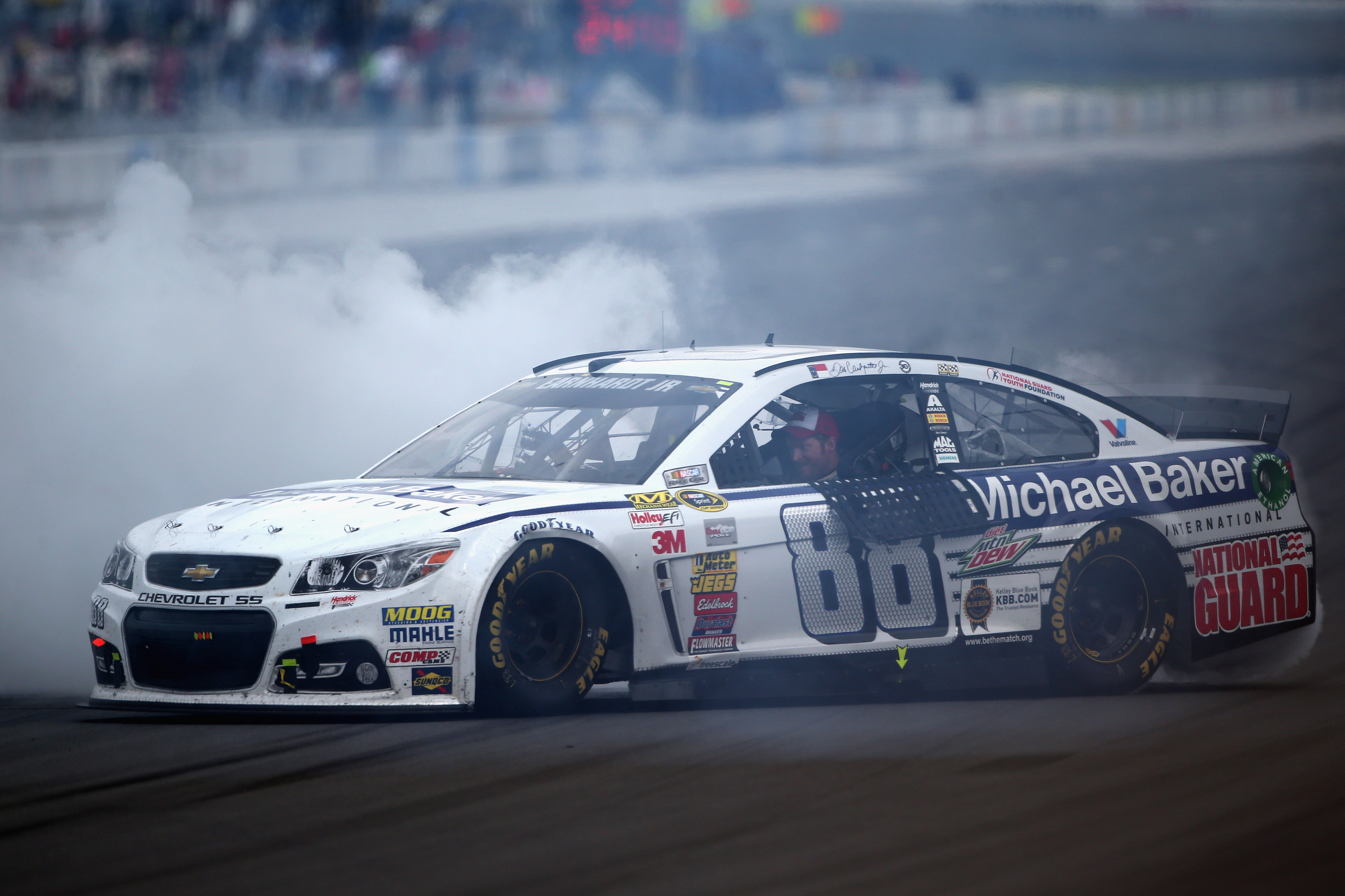Earnhardt Jr. Holds off Kevin Harvick to win Pocono