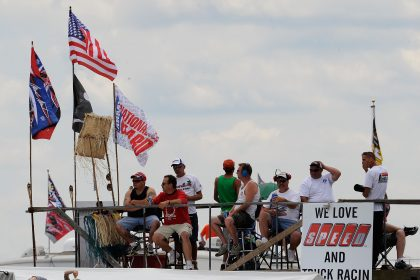 LONG POND, PA - JULY 31: Fans watch the action from the infield of the NASCAR Camping World Truck Series Pocono Mountains 125 at Pocono Raceway on July 31, 2010 in Long Pond, Pennsylvania. (Photo by Rusty Jarrett/Getty Images for NASCAR)